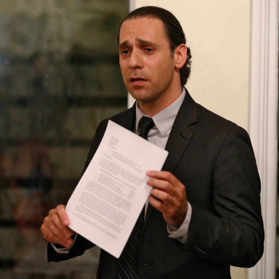 HMK landlord Khraish Khraish holds a copy of his development plan for his West Dallas properties. (File Photo/The Dallas Morning News)