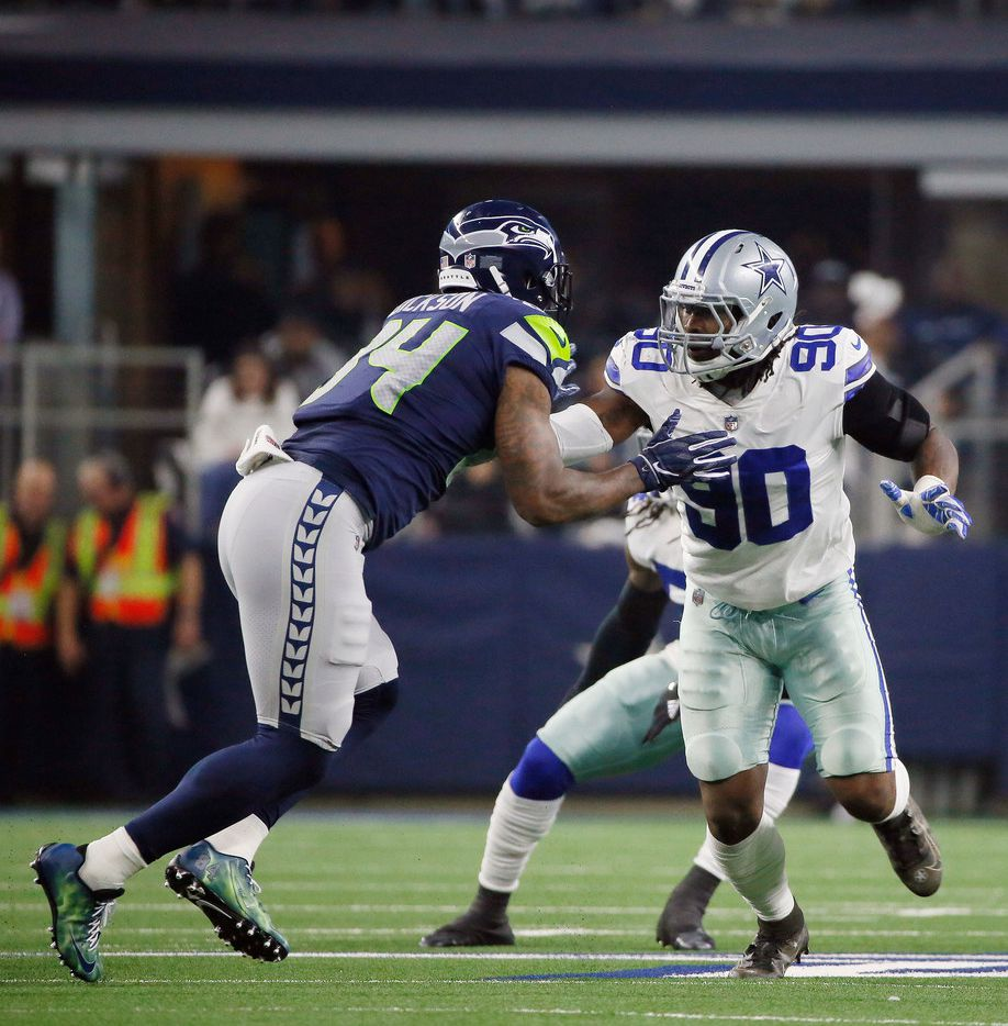 Dallas Cowboys defensive end Demarcus Lawrence (90) works against the Seattle Seahawks during the first half of the NFC wild-card NFL football game in Arlington, Texas, Saturday, Jan. 5, 2019. (AP Photo/Roger Steinman)