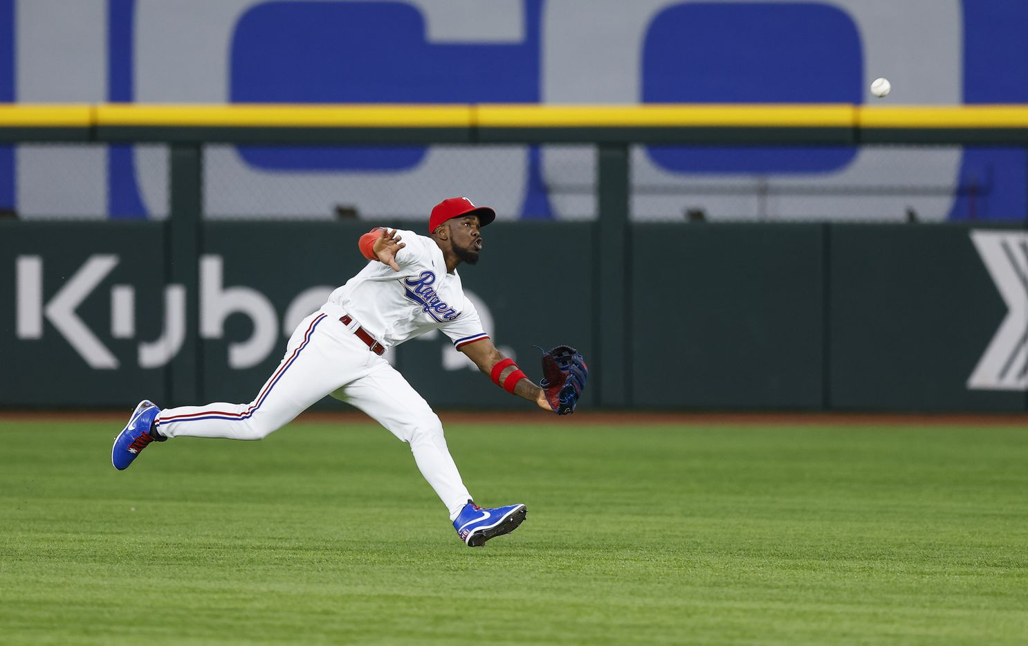 Texas Rangers center fielder Adolis Garcia (53) catches a fly out hit by Oakland Athletics' Tony Kemp during the ninth inning of a baseball game in Arlington, Monday, June 21, 2021. Texas won 8-3. (Brandon Wade/Special Contributor)