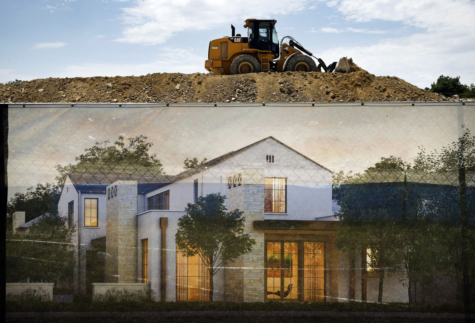 Construction is underway on the new gated community on Walnut Hill Lane just west of U.S. 75 in Dallas on Wednesday.