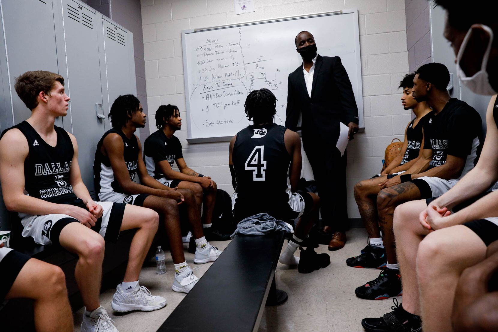 Dallas Christian College basketball players listen to coach Dwight Coleman in the locker room during halftime against Abilene Christian University, a NCAA Division I team, in Abilene on Tuesday, Dec. 29, 2020. Dallas Christian trailed ACU 54-21 at halftime. (Juan Figueroa/ The Dallas Morning News)