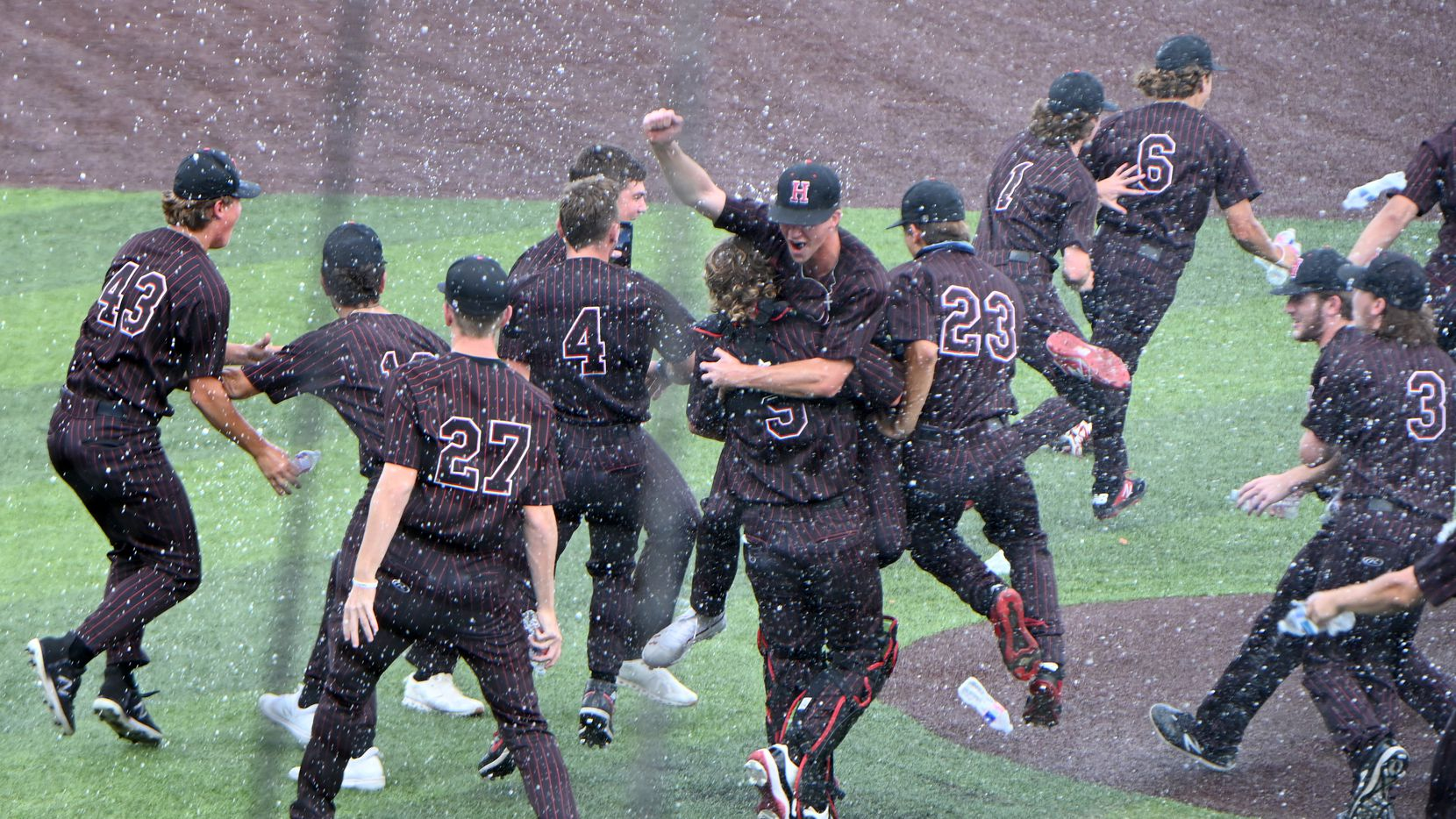 Rockwall Heath players celebrate their 11-3 win during Game 3 of the UIL Region II final series between Rockwall and Rockwall Heath, Saturday, June 5, 2021, in Dallas.