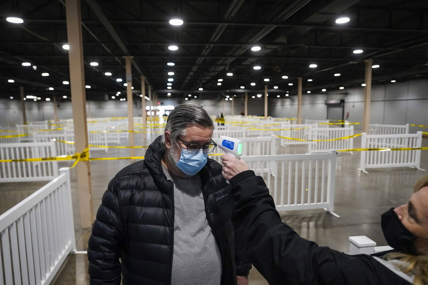 Davis Mosmeyer, 69, entered Fair Park in Dallas on Monday, January 11, 2021, to undergo a temperature test when entering the building in front of the production line. Dallas County launched its first