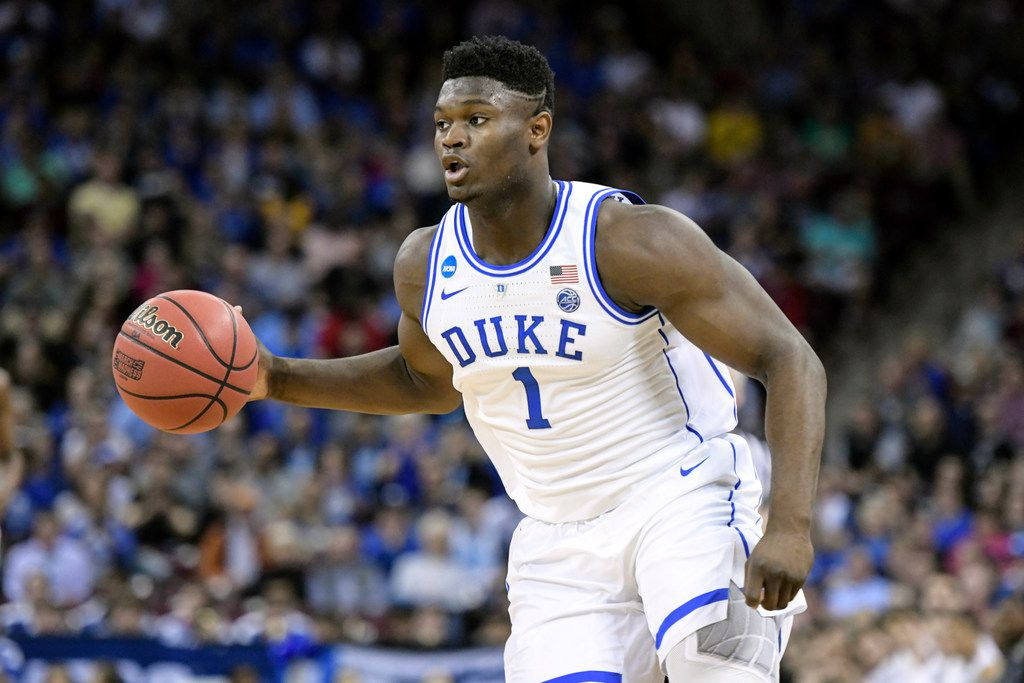 FILE - In this March 24, 2019, file photo, Duke forward Zion Williamson (1) dribbles the ball against Central Florida during the first half of a second-round game in the NCAA men's college basketball tournament in Columbia, S.C. (AP Photo/Sean Rayford, File)