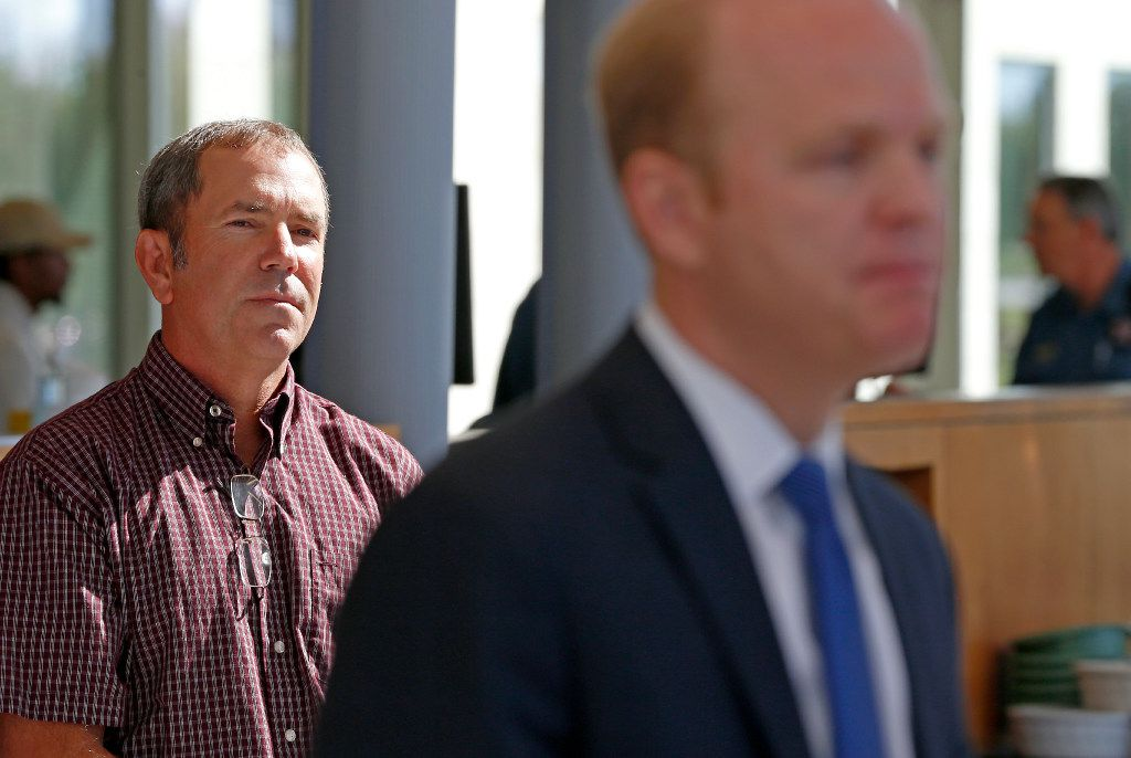 Christina Morris' father, Mark Morris, left, listens to prosecutor Zeke Fortenberry talk about the case.
