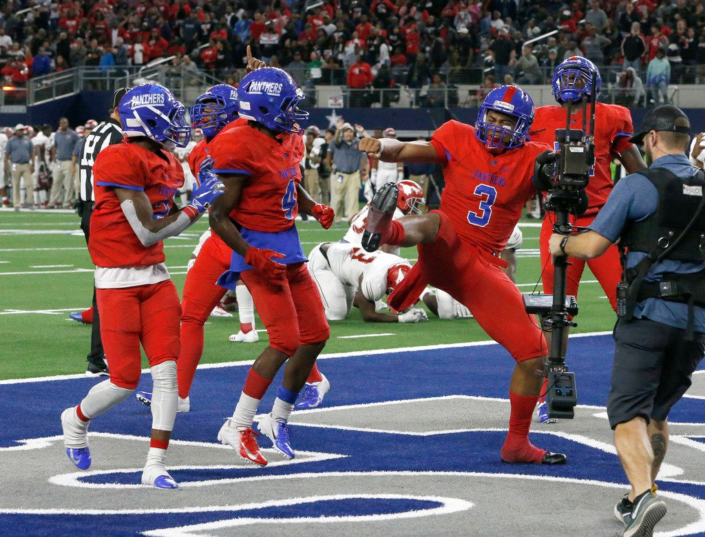 Duncanville's quarterback Ja'Quinden Jackson (3) celebrates a touchdown against Galena Park North Shore in the second of their Class 6A Division I football state championship game at AT&T Stadium in Arlington, Texas on Dec 22, 2018. Galena won 41-36.  (Nathan Hunsinger/The Dallas Morning News)
