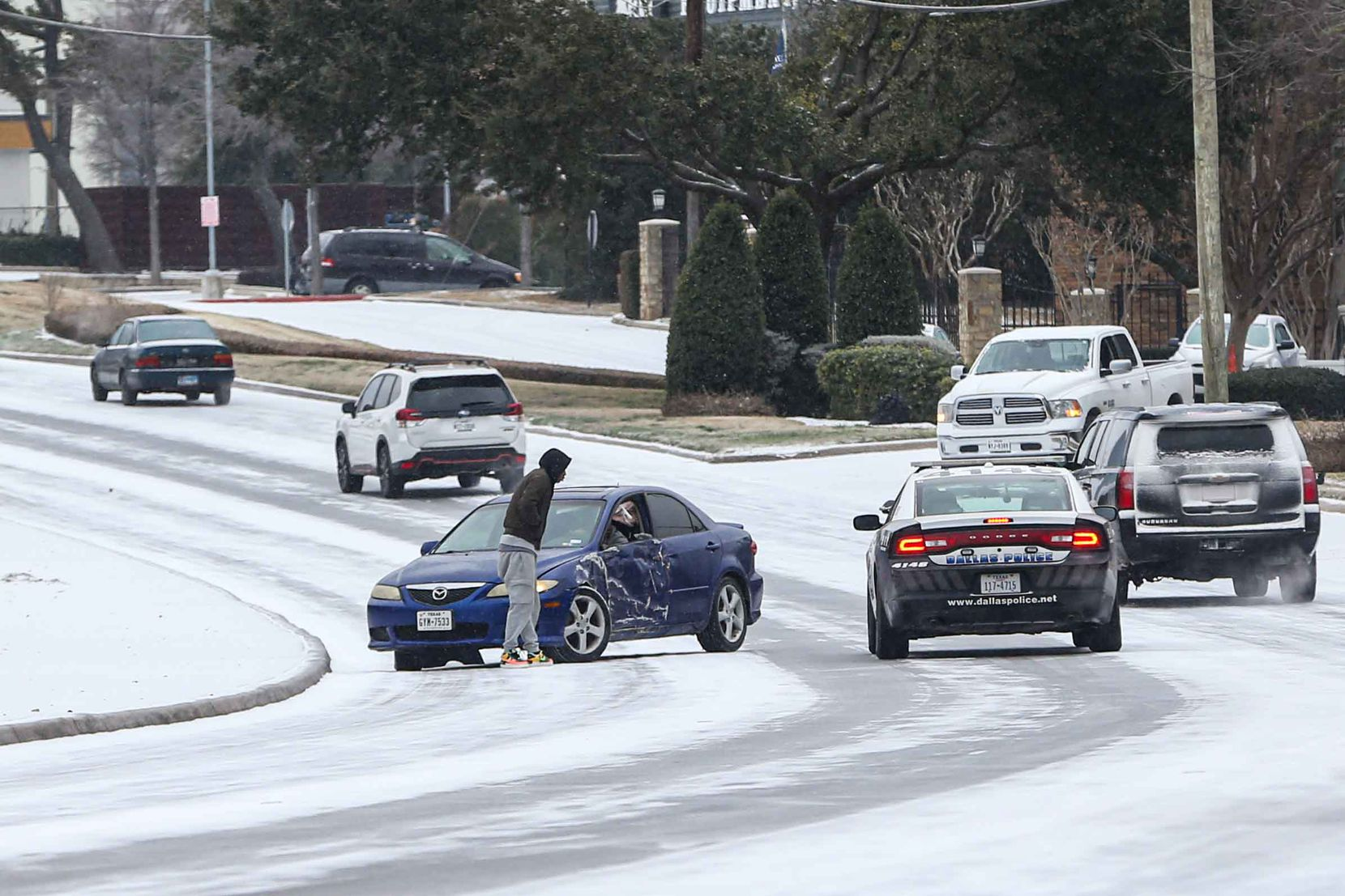 A car crash on TX-12 Loop Northwest near Shady Brook Ln as winter flurries arrive in Dallas on Sunday, February 14, 2021 ahead of major snowstorm.