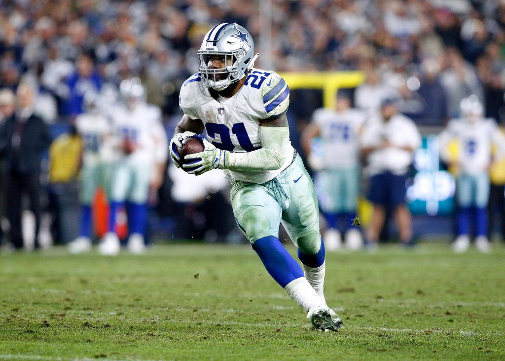 Dallas Cowboys running back Ezekiel Elliott (21) carries the ball after quarterback Dak Prescott (4) flipped it to him during the fourth quarter of their NFC Divisional Playoff game against the Los Angeles Rams at Los Angeles Memorial Coliseum in Los Angeles, Saturday, January 12, 2019. Tye Cowboys lost 30-22. (Tom Fox/The Dallas Morning News)