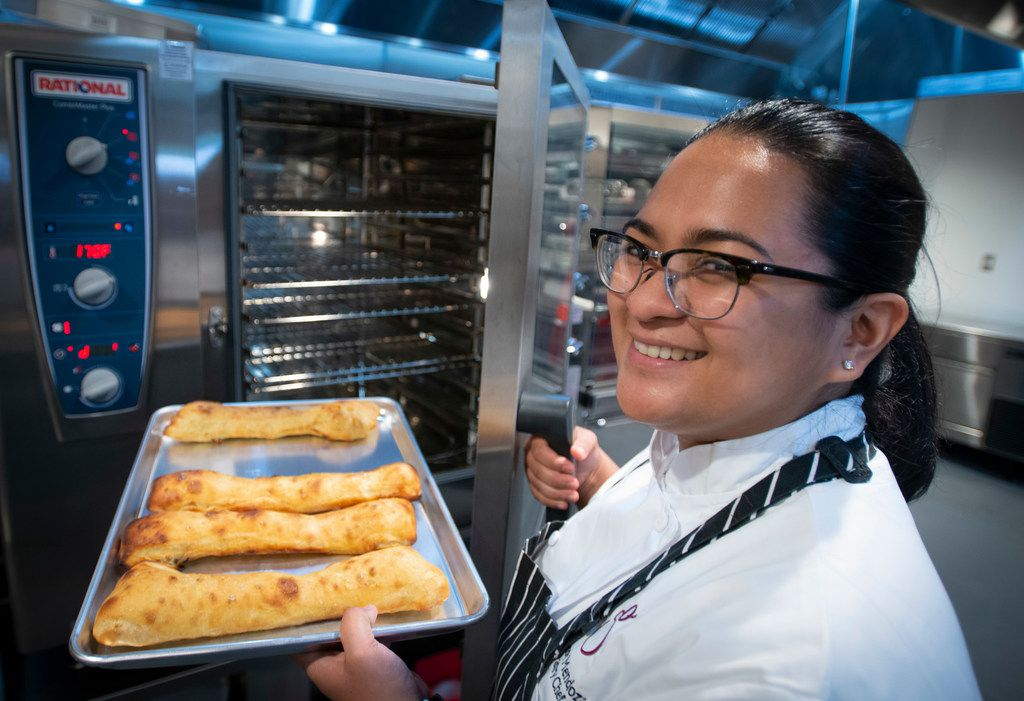 Pastry chef Cessy Mendoza with a batch of stecca, an Australian bread that's like a cross between focaccia and ciabatta.