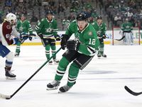 Dallas Stars center Radek Faksa (12) brings the puck up ice against the Colorado Avalanche during the first period at the American Airlines Center in Dallas, Thursday, October 7, 2021.