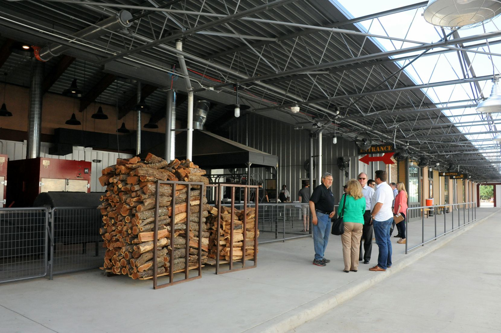 Due to temperatures that can reach over 700 degrees, the smokers are located on the exterior of the restaurant, where guests can watch the meats being smoked at the new Ten 50 BBQ in Richardson.