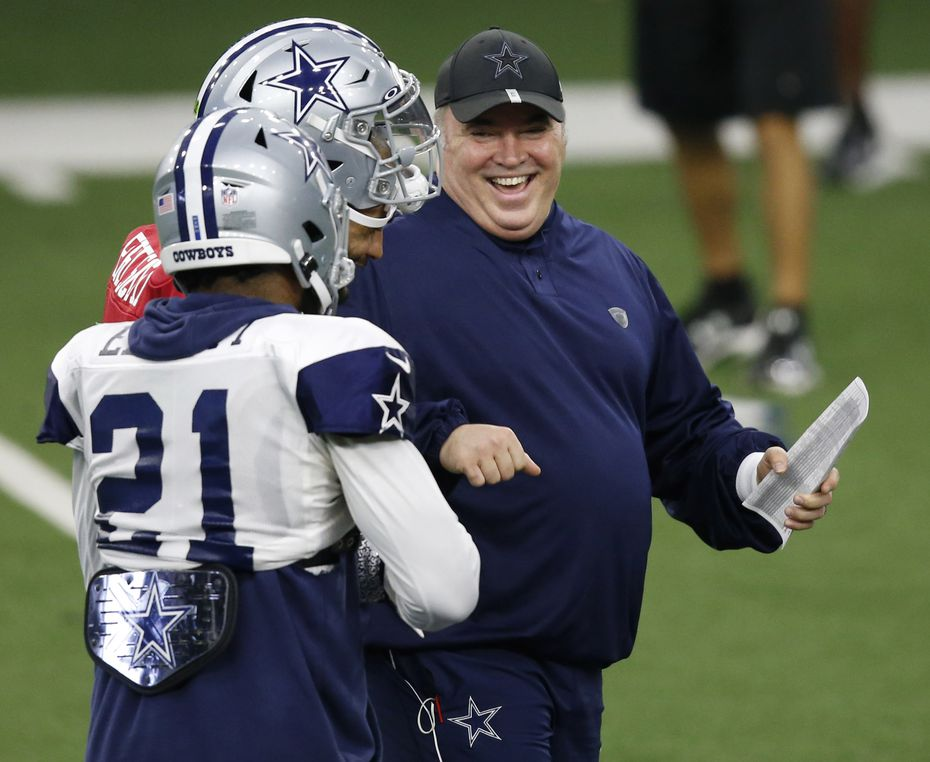 Dallas Cowboys head coach Mike McCarthy laughs as he talks with Dallas Cowboys quarterback Dak Prescott (4) and Dallas Cowboys running back Ezekiel Elliott (21) during training camp at the Dallas Cowboys headquarters at The Star in Frisco, Texas on Monday, August 17, 2020. (Vernon Bryant/The Dallas Morning News)