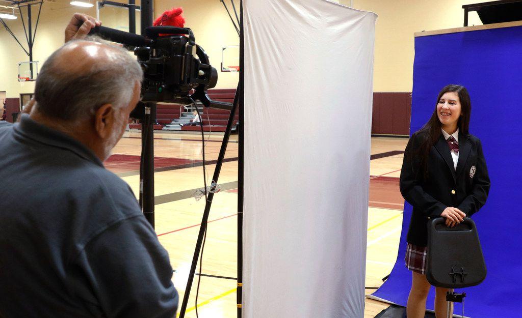 Mark Rachall takes a school portrait of Gabriela Faber, 15, at the International Leadership of Texas' Keller-Saginaw High School. (David Woo/Staff Photographer)