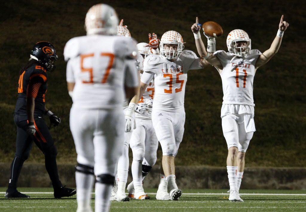 (TXHSFB) Celina High's Shane Gerths (35) holds the football high, as he celebrates with teammates, including Trace Young (11), after returning an interception for a touchdown in the final minutes of the team's 44-49 win over Gilmer in a high school football playoff game on Friday, December 11, 2014. (John F. Rhodes / Special Contributor)