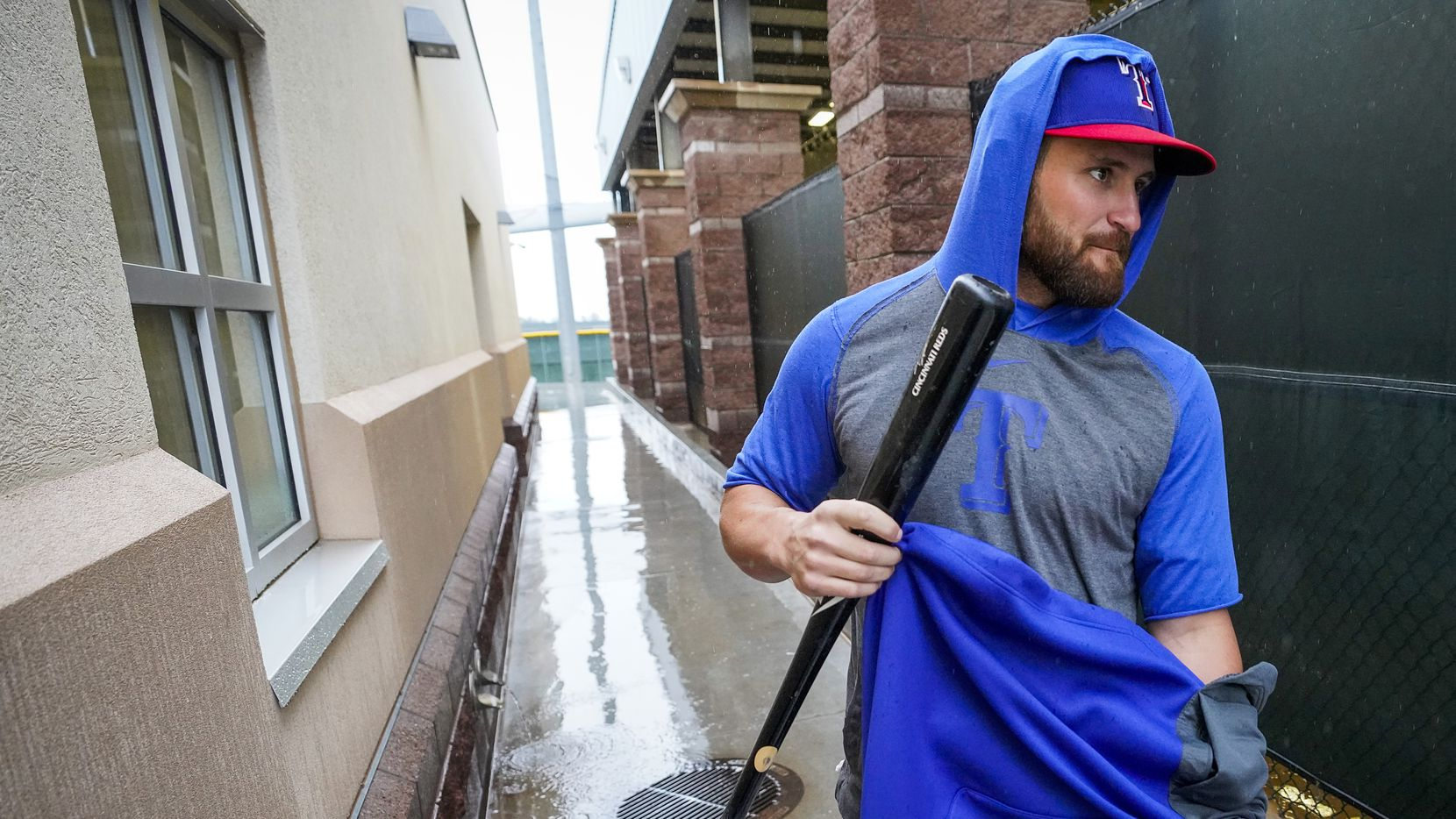 Texas Rangers catcher Nick Ciuffo puts on a warmup as he heads to the indoor batting cage during a spring training workout at the team's spring training facility on Saturday, Feb. 22, 2020, in Surprise, Ariz. The Rangers scheduled game against the Milwaukee Brewers was cancelled due to the weather.