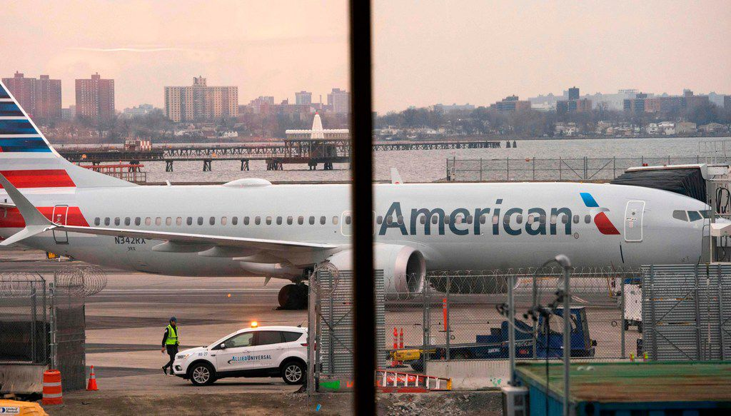 An American Airlines 737 Max sits at the gate at LaGuardia airport in New York.