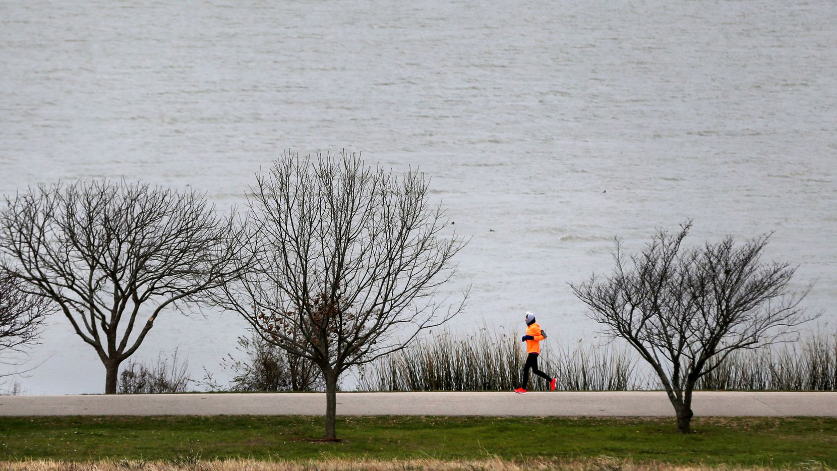 Susan Tiner ran in 24-degree weather at White Rock Lake in Dallas on Monday morning.