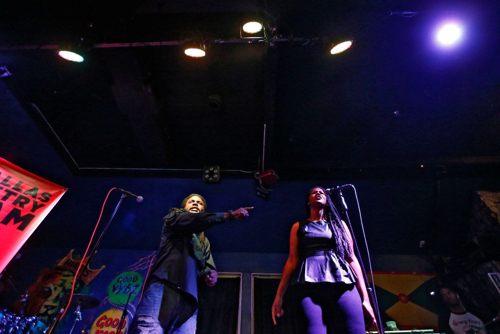 Wayne Henry (left) and  Melania Luisa perform during All Star Slam hosted by the Dallas Poetry Slam team at Heroes Lounge in Dallas on July 28, 2017.   (Nathan Hunsinger/The Dallas Morning News)