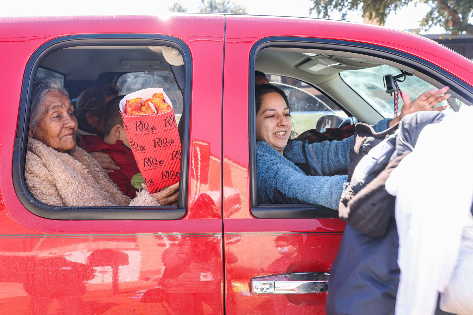 Guadale Lupe (left) and Yajaira Cantu picked up food from volunteers at Ledbetter Eagle Ford Community Pantry, housed at at Iglesia Bautista El Calvario in West Dallas.