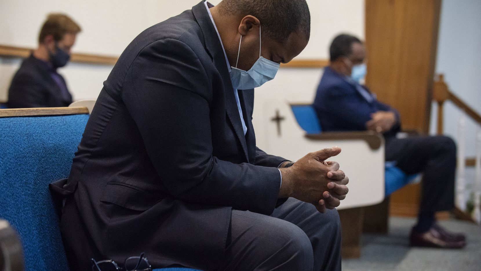 Dallas Mayor Eric Johnson bows his head during a special prayer event with several area pastors at Dallas West Church of Christ.