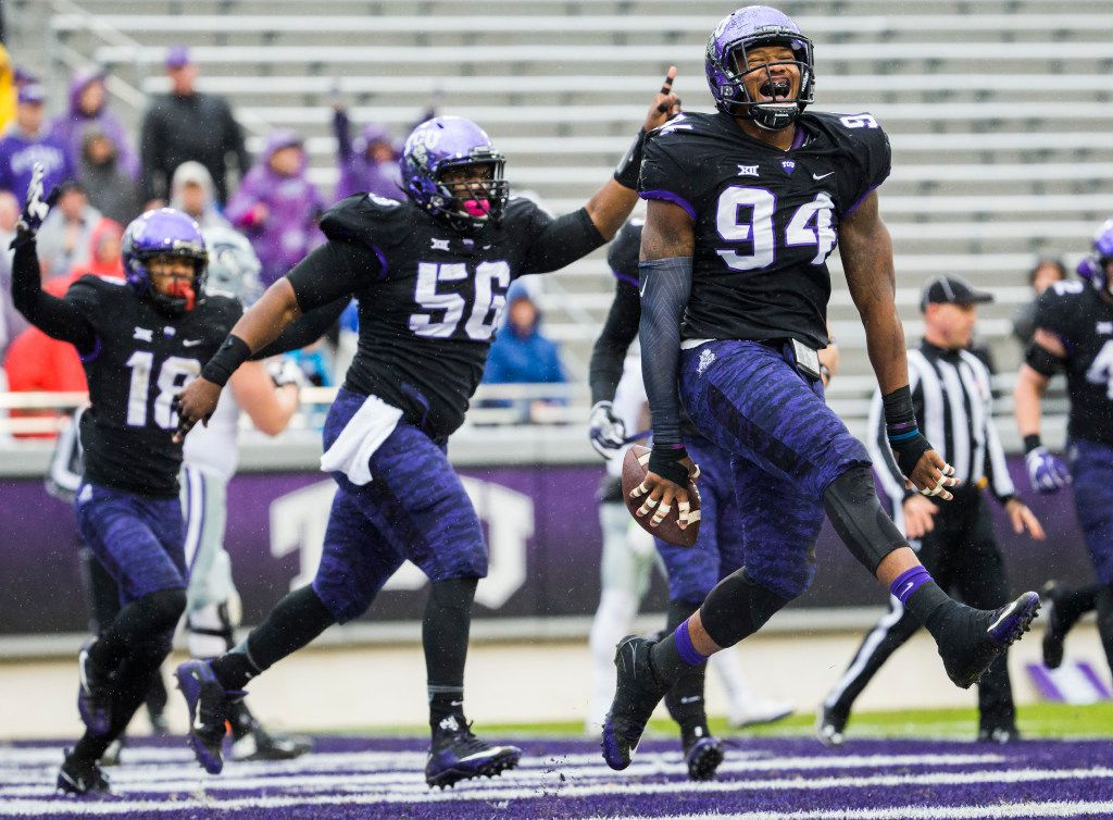 TCU Horned Frogs defensive end Josh Carraway (94) celebrates after recovering a fumble and running it in for a touchdown during the first quarter of their game against the Kansas State Wildcats on Saturday, December 3, 2016 at Amon G. Carter Stadium in Fort Worth. The touchdown was overturned by officials after the fumble was ruled an incomplete pass. (Ashley Landis/The Dallas Morning News)