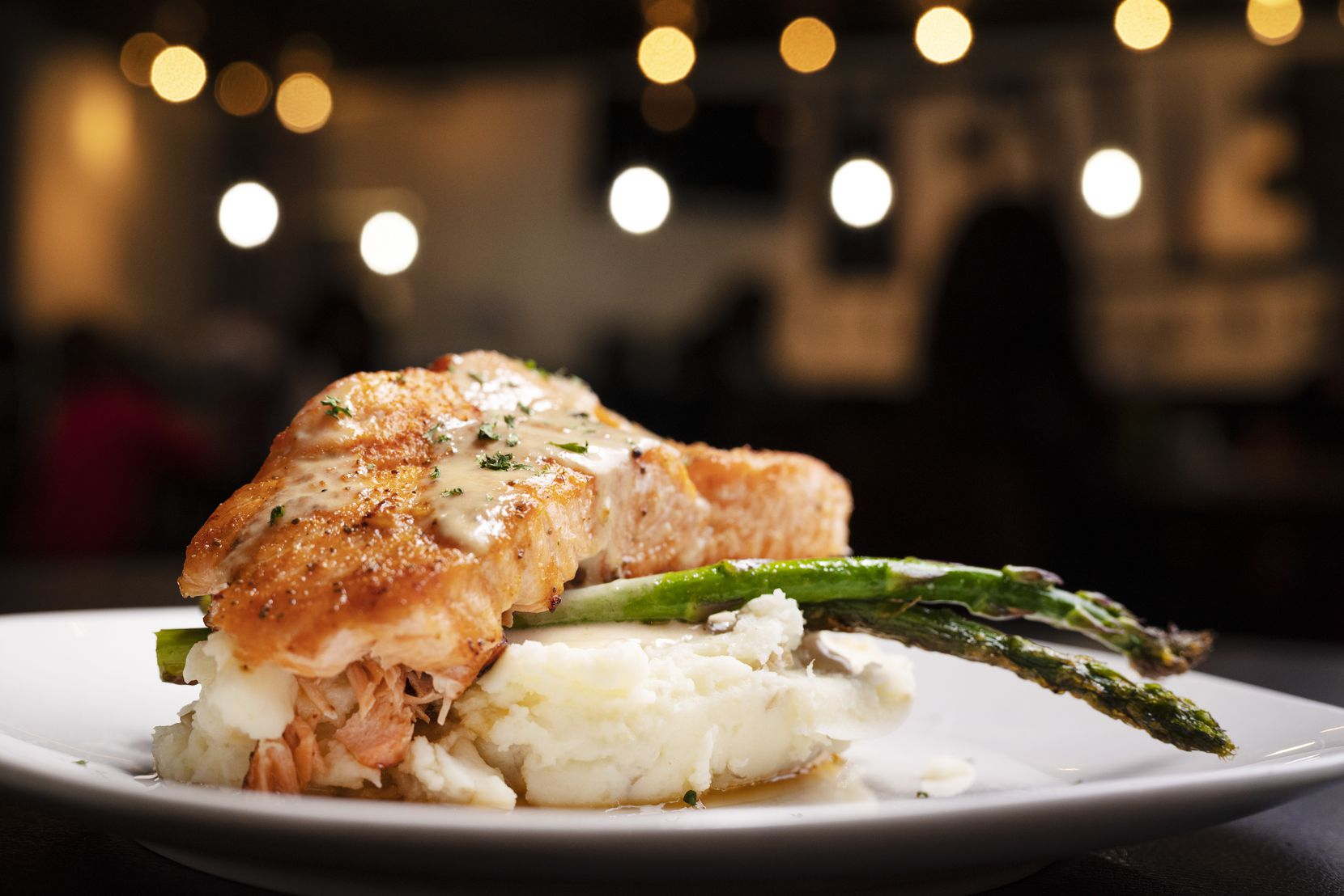 Creamed spinach stuffed salmon is one of the dishes on the menu at The Five Experience restaurant in Dallas.