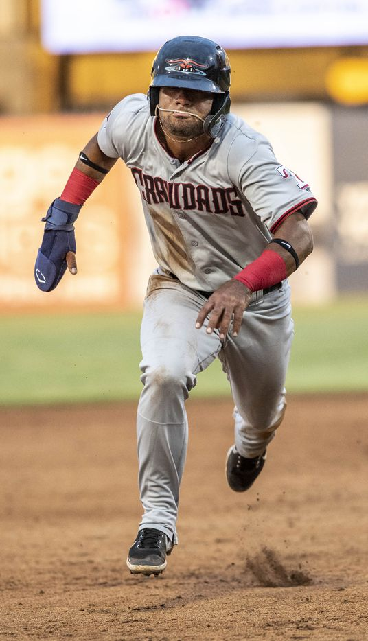 Hickory Crawdad's Ezequiel Duran (17) runs to third base on a hit and run during the game with the Greensboro Grasshopper's at First National Bank Field on Friday, August 6, 2021 in Greensboro, N.C. (Woody Marshall/Special Contributor)