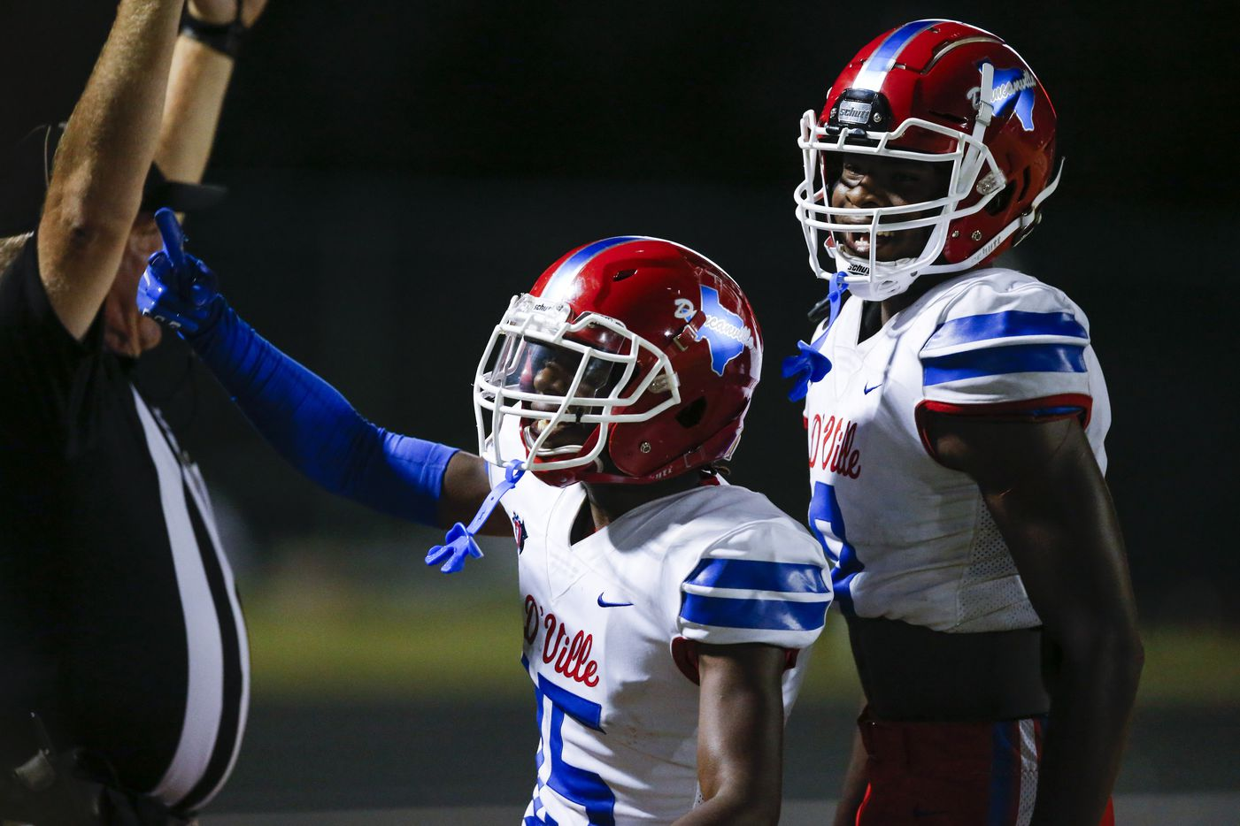 Duncanville junior defensive back Lamoderick Spencer, center, celebrates scoring a touchdown during the second half of a high school football game against DeSoto at DeSoto High School, Friday, September 17, 2021. Duncanville won 42-21. (Brandon Wade/Special Contributor)