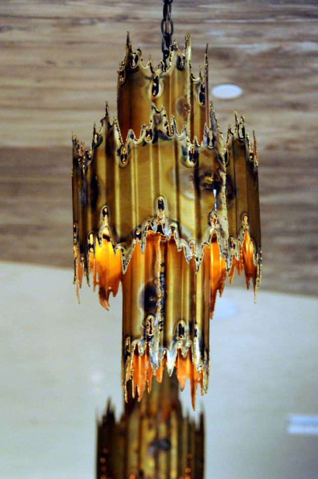 Vintage 1960's lamps by artist Tom Green are on display at Madrina.