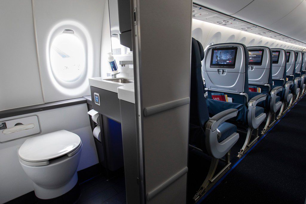 One of the aft lavatories includes a window on the Airbus A220.
