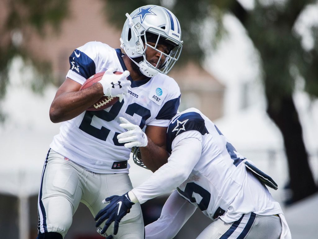 Dallas Cowboys running back Alfred Morris (23) runs a drill with running back Darius Jackson (26) during a morning practice at training camp in Oxnard, California on Tuesday, July 30, 2019. (Ashley Landis/The Dallas Morning News)