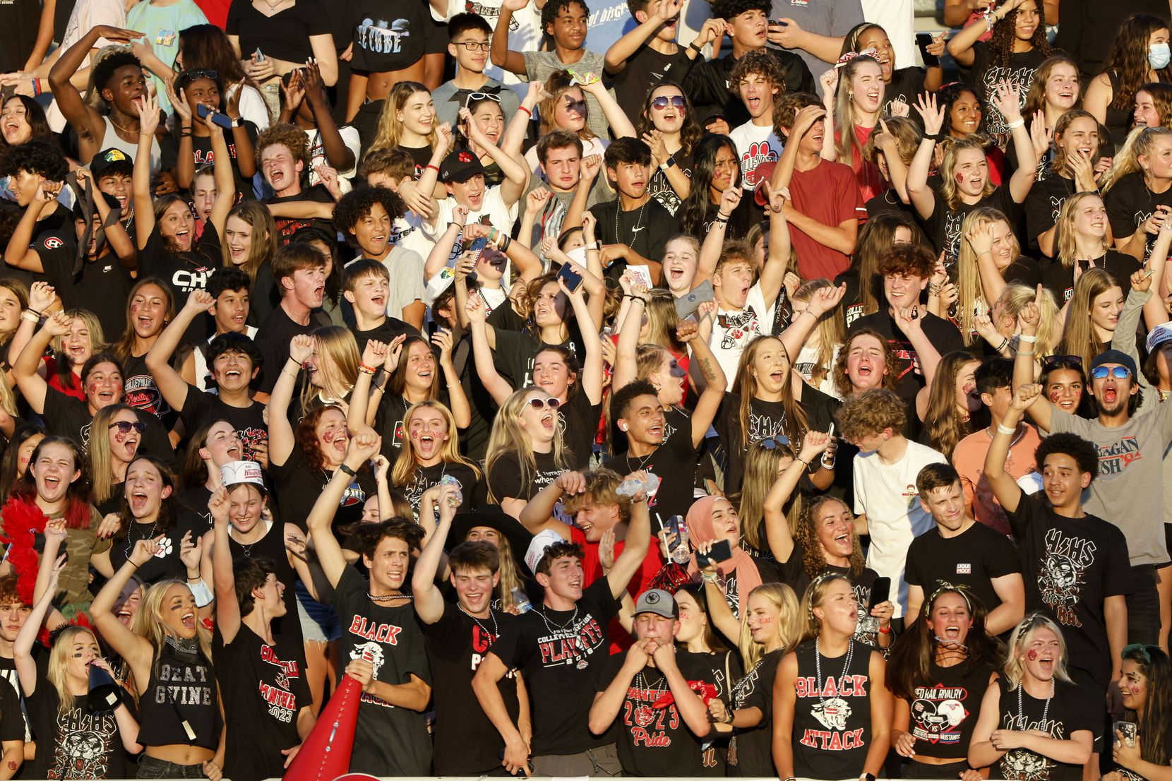 The Colleyville Heritage student section cheers as they played Grapevine during the first half of their high school football game in Grapevine, Texas on Aug. 27, 2021. (Michael Ainsworth/Special Contributor)