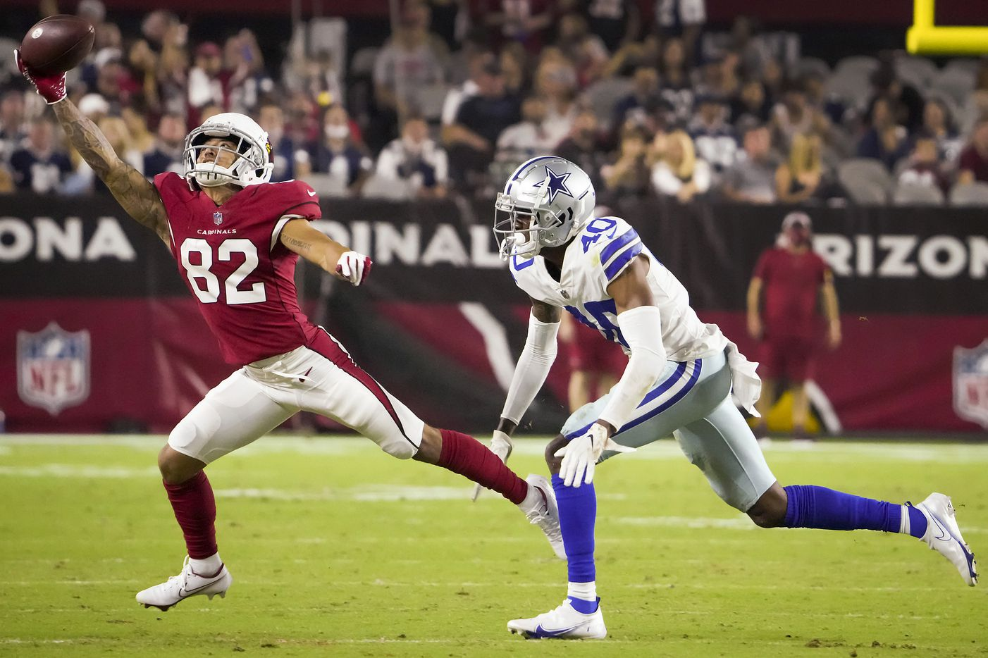 Arizona Cardinals wide receiver Andre Baccellia (82) has a pass go off his fingers as Dallas Cowboys cornerback Nahshon Wright (40) defends during the second half of a preseason NFL football game at State Farm Stadium on Friday, Aug. 13, 2021, in Glendale, Ariz.