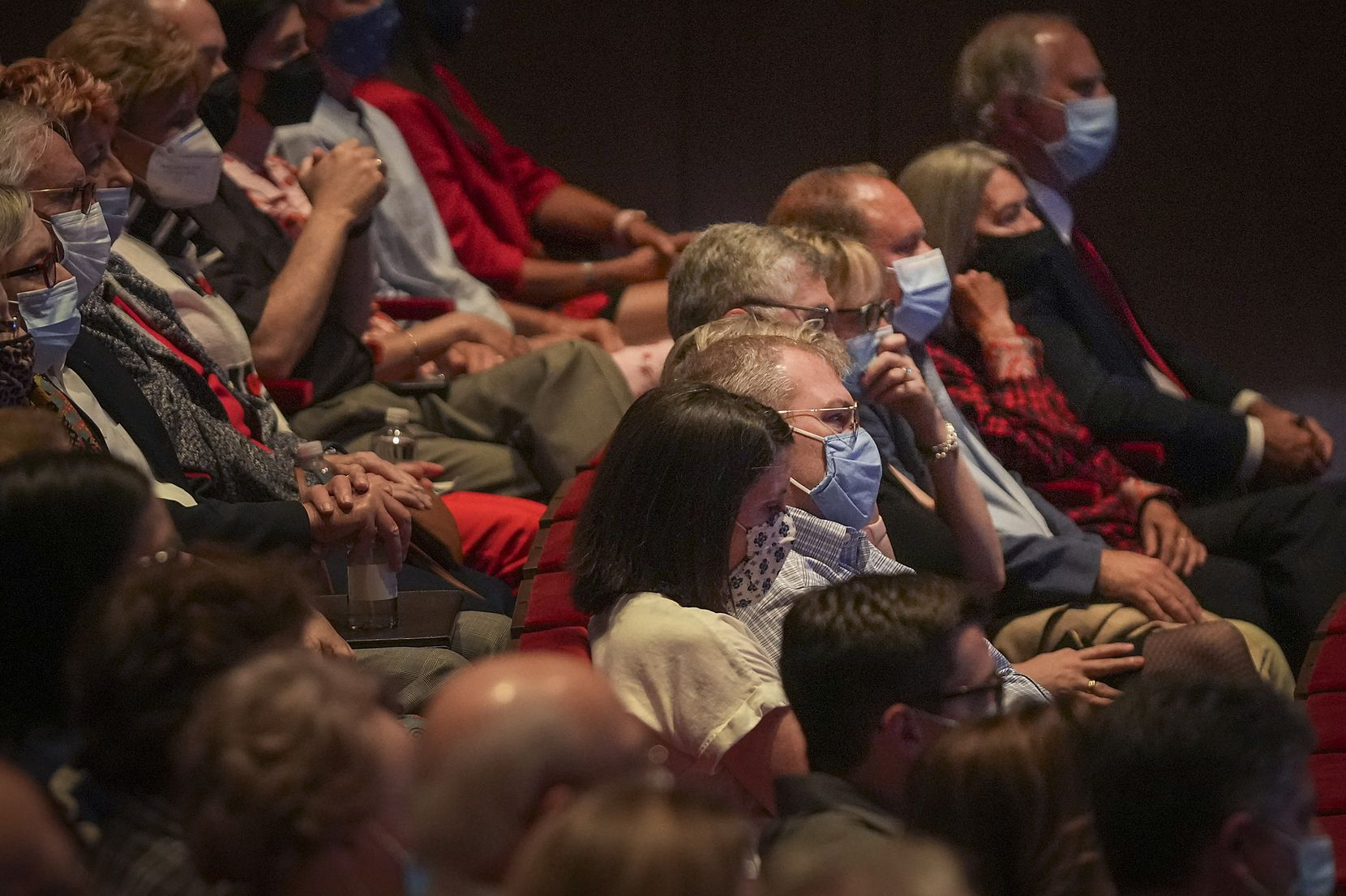 Guests watch a video of former President George W. Bush's speech at Shanksville, Pa., which he delivered earlier Saturday.