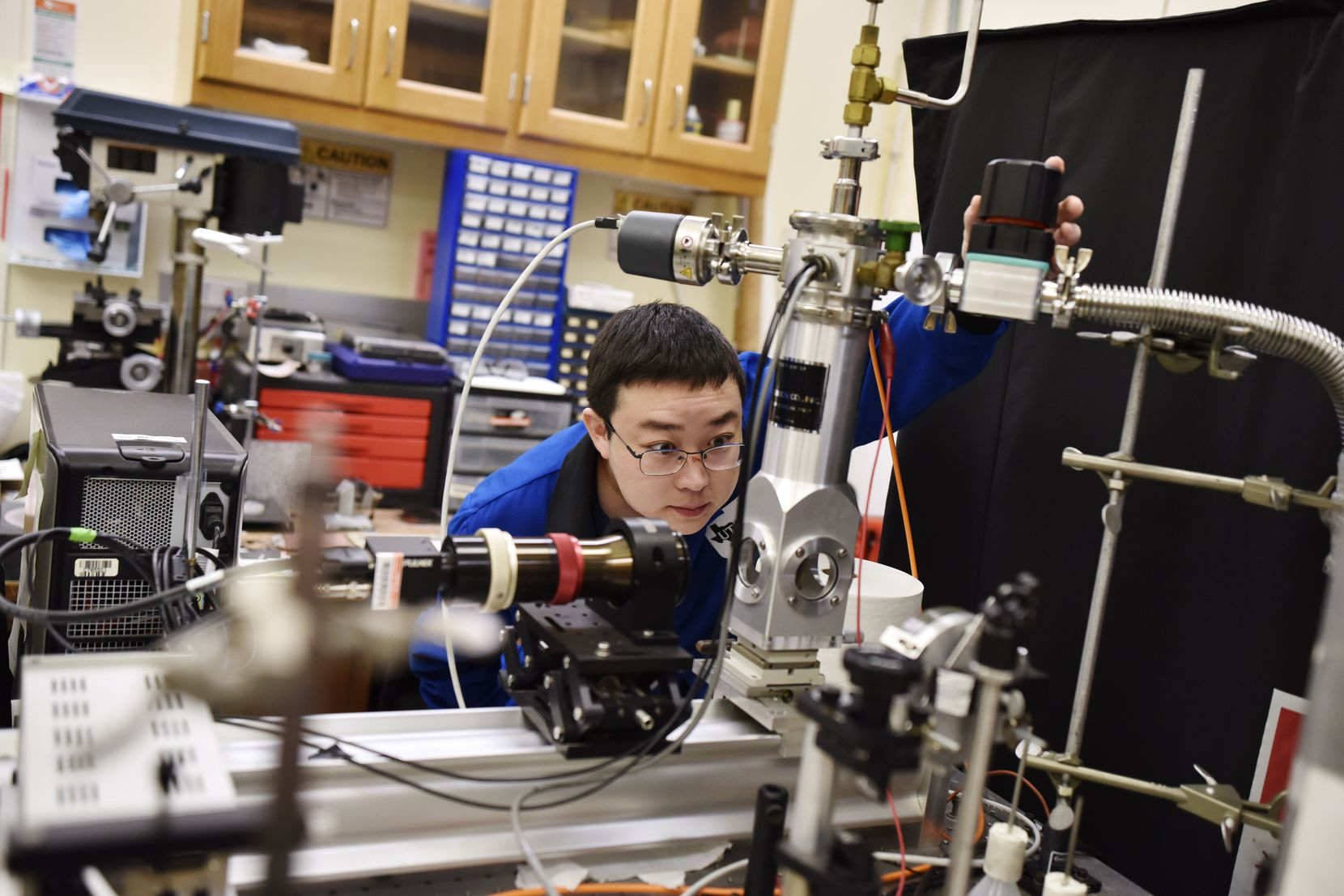 Graduate student Zhong Wang inspects equipment and devices that are used to transfer heat at the Nano Tech Institute lab on the campus of UTD in Richardson on Oct. 24, 2019.