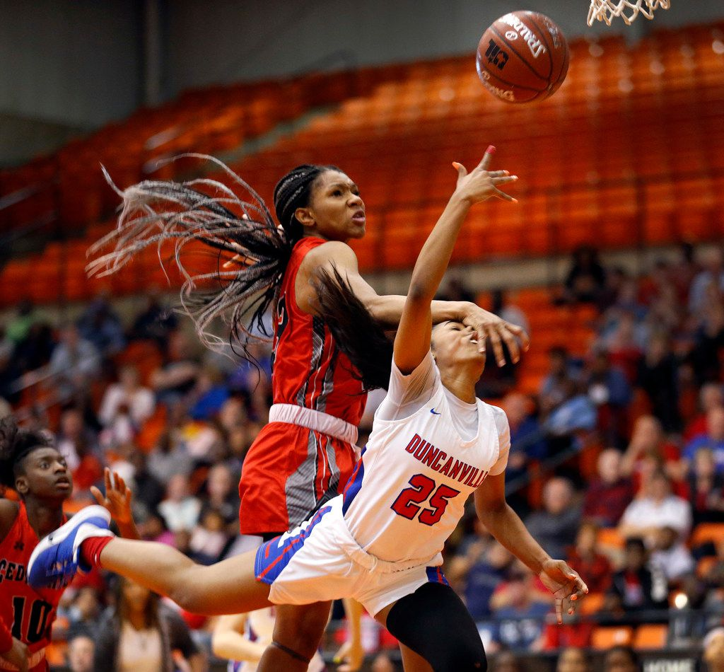 Duncanville's  Deja Kelly (25) is fouled by Cedar Hills' Anzhane' Hutton (23) as she lays up a shot during the second half of the Class 6A Region I championship game at Wilkerson-Greines Activity Center in Fort Worth, Saturday, February 29, 2020. Duncanville won the title game, 56-54. (Tom Fox/The Dallas Morning News)