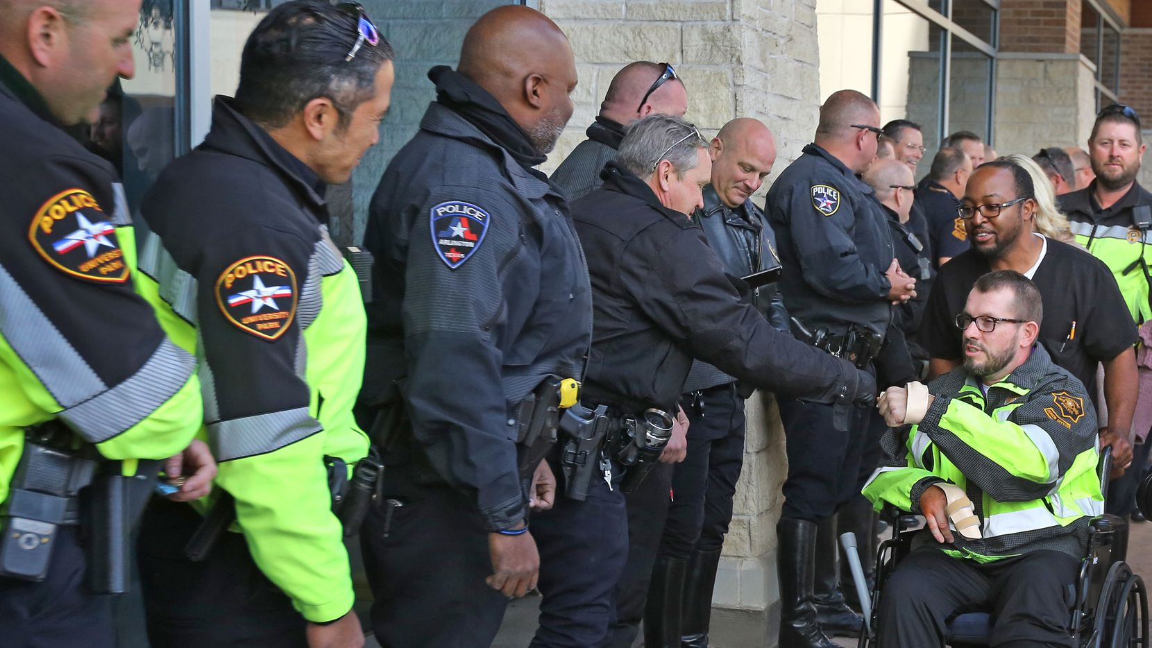 Grapevine Police Senior Officer RJ Hudson is greeted by fellow law enforcement officers from around the area after being released from Baylor Scott & White Medical Center-Grapevine, after being seriously injured in a crash five weeks ago on his motorcycle.