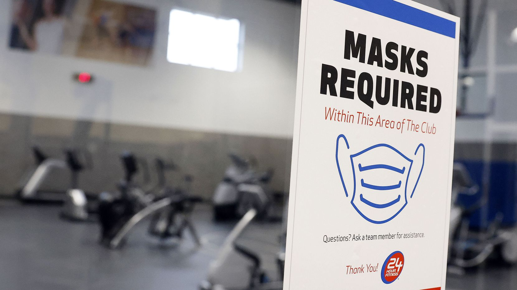 The 24 Hour Fitness in McKinney, Texas, set up their gymnasium as a mask only workout area, Wednesday, March 10, 2021. Members who feel more comfortable in a mask-only environment have aerobic machines and dumbbells they can use. As gyms react to the lifting of Gov. Abbott's mask mandate and other restrictions, most have seen mask requirements as a binary decision. 24 Hour Fitness will attempt to keep a leg on both sides of the aisle establishing masked and mask-free zones within each of its fitness clubs.