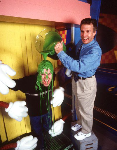 In this DMN file photo, Double Dare 2000 host Jason Harris gets slimed by Marc Summers, host of the original Double Dare. The show is going on tour and stopping in Grand Prairie April 13, 2019.