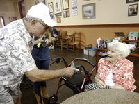 Glenn Moore talks with Wanda Fern Winter, known as Fernie, at The Dock at the State Fair of Texas in Dallas in 2014. Winter and her family have sold food at the fair for more than 50 years.