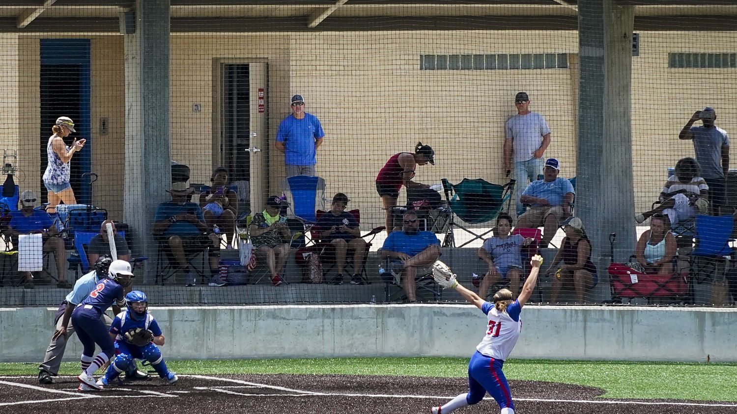 Fans watch a softball game between the Texas Glory 18U team (in white jerseys) and the American Freedom Gold Coleman 18U in the Triple Crown Texas State Tournament at Spirit Park on Monday, June 15, 2020, in Allen, Texas.