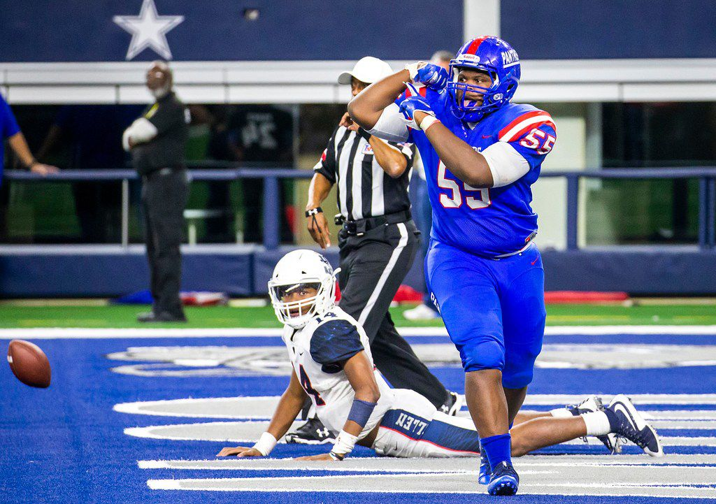 Duncanville defensive lineman De'Braylon Carroll (55) flexes in celebration after sacking Allen quarterback Grant Tisdale (14) for a safety during the fourth quarter of a Class 6A Division IÊstate semifinal at AT&T Stadium on Saturday, Dec. 15, 2018, in Arlington. (Smiley N. Pool/The Dallas Morning News)