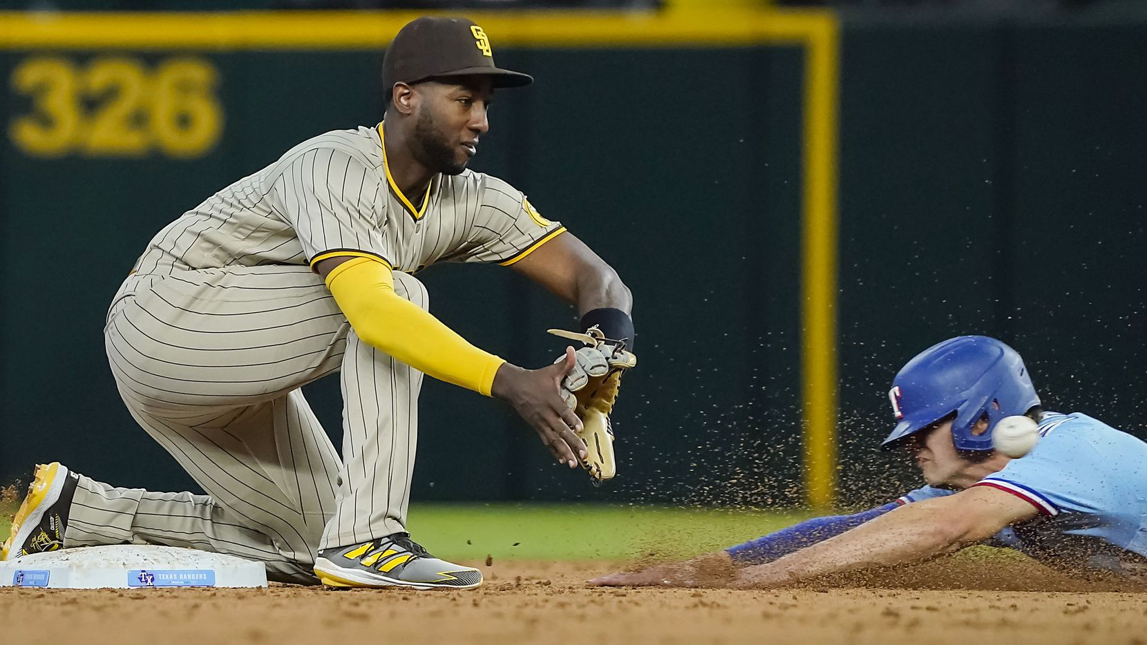 Texas Rangers outfielder Eli White is caught stealing as San Diego Padres second baseman Jurickson Profar takes the throw during the eighth inning at Globe Life Field on Sunday, April 11, 2021. (Smiley N. Pool/The Dallas Morning News)