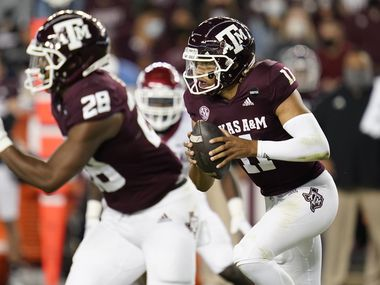 Texas A&M quarterback Kellen Mond (11) rushes against Arkansas during the first quarter of an NCAA college football game Saturday, Oct. 31, 2020, in College Station, Texas. (