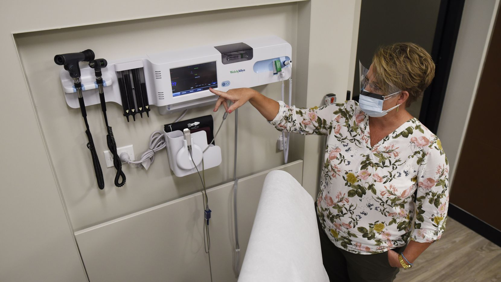 Registered nurse Jodyne Schlachter explains the technology in one of the clinical rooms at the new Amazon health center in Irving. Amazon plans to open five additional clinics in North Texas this year.