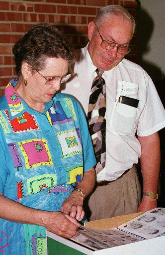 In a 1997 photo, Cal Farley's Boys Ranch Superintendent Lamont Waldrip (right) looks over a 1956 Boys Ranch High School yearbook with wife Frances.  Lamont retired that same year after 42 years as superintendent.