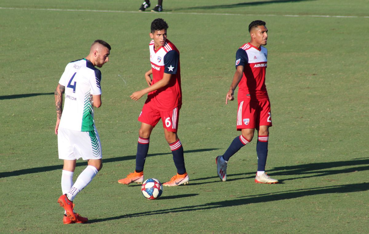 Jesus Ferreira points to the spot where he believes a foul should have been called against the OKC Energy in US Open Cup play while Ricardo Pepi of FC Dallas and Callum Ross of OKC Energy look on. (6-12-19)