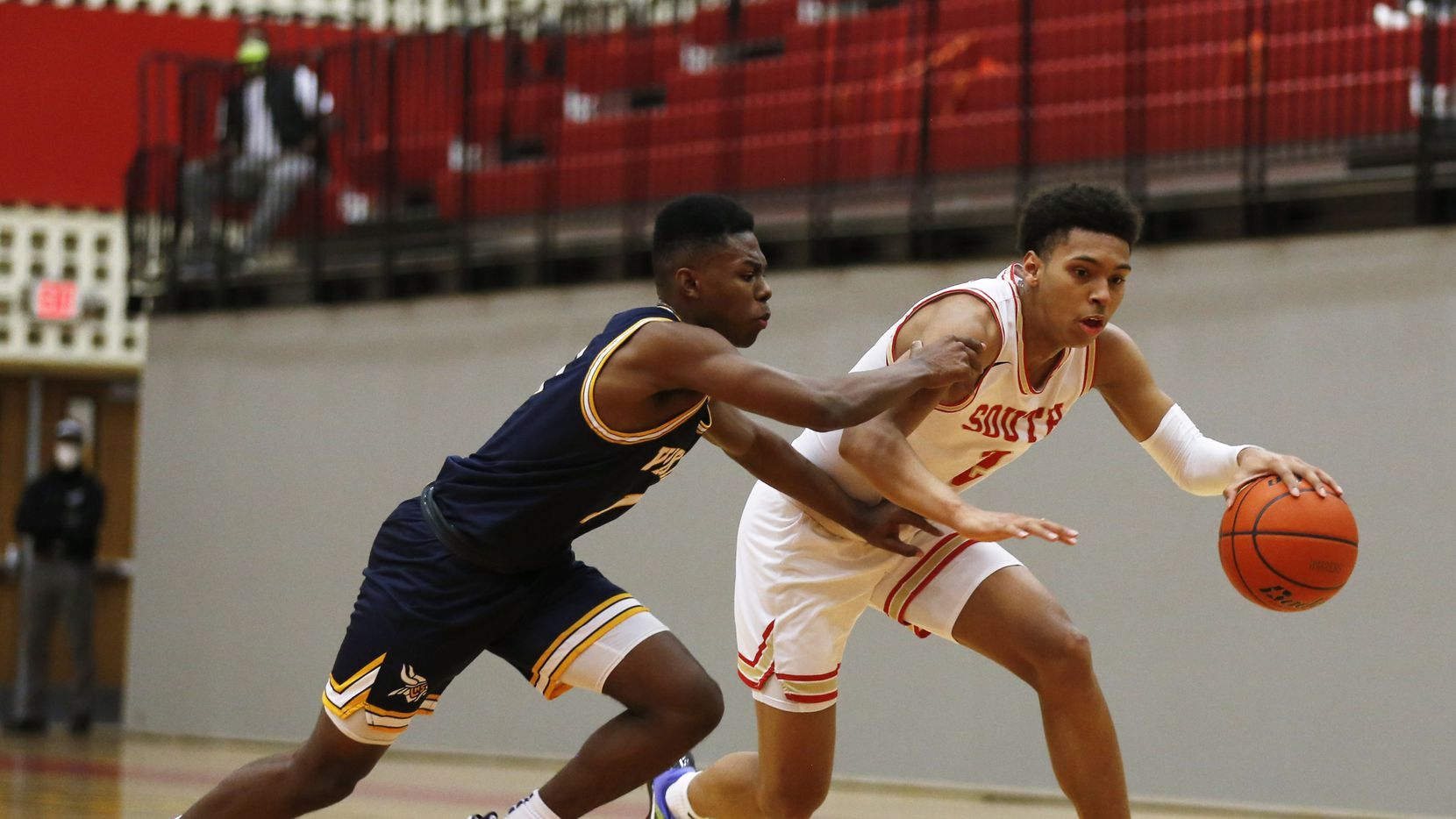 South Grand Prairie's Jordan Roberts (2) drives towards the basket as  Arlington Lamar's Jalen Ware-Williams (1) defends  during the first quarter of play at South Grand Prairie High School on Tuesday, January 19, 2021in Grand Prairie, Texas.