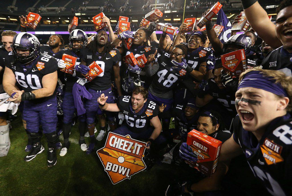 TCU players celebrate a 10-7 overtime win against California in the Cheez-It Bowl NCAA college football game Wednesday, Dec. 26, 2018, in Phoenix. (AP Photo/Ross D. Franklin)