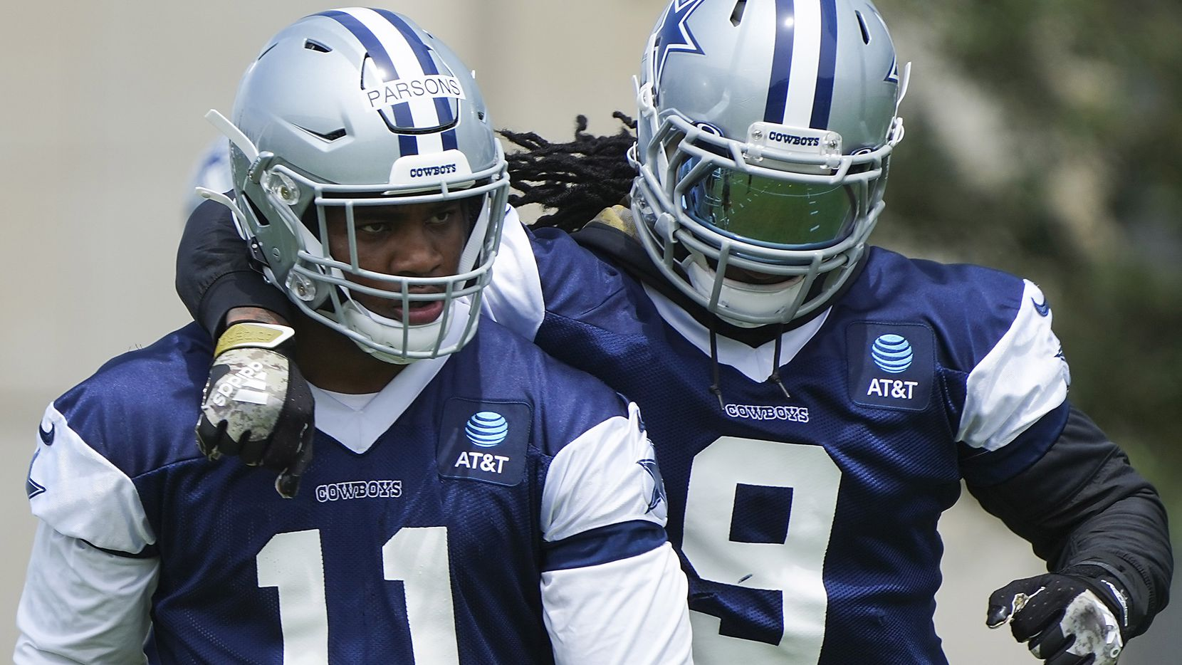 Dallas Cowboys linebacker Jaylon Smith (9) puts an arm around linebacker Micah Parsons (11) during a minicamp practice at The Star on Tuesday, June 8, 2021, in Frisco.